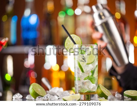 fresh mojito drink on bar desk, close-up. - stock photo