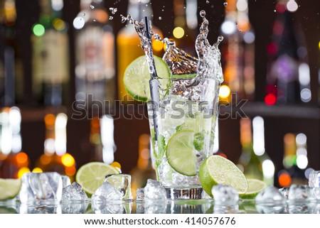 fresh mojito drink on bar desk, close-up. - stock photo