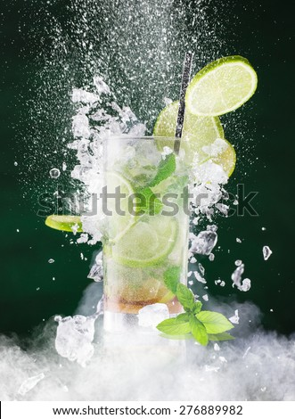 fresh mojito drink with liquid splash, freeze motion. - stock photo
