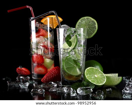 Fresh mojito drinks over black - stock photo