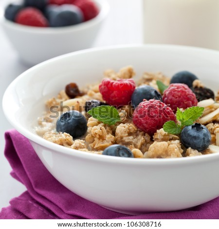 fresh muesli with fruits and milk - stock photo