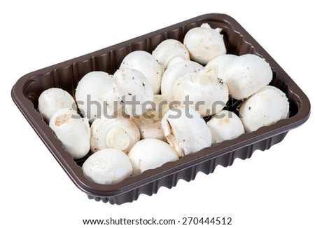 Fresh Mushrooms in a plastic container isolated on white background. - stock photo