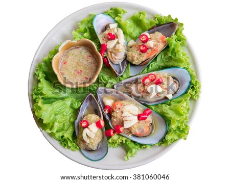 Fresh Mussels With Spicy Sauce On White Background - stock photo