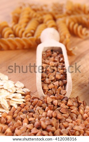 Fresh, natural ingredients and products containing magnesium and dietary fiber, healthy food and nutrition, wholemeal pasta, buckwheat, oatmeal - stock photo