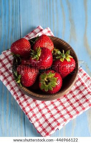 Fresh natural strawberries in wooden bowl. Healthy vegan food concept. Summer eco fruits and vegetables.