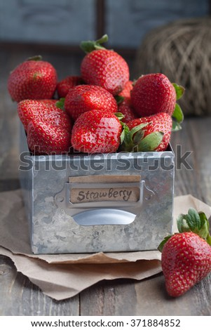 Fresh natural strawberry in a metal rustic box with label - stock photo