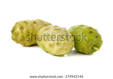 fresh noni fruit on white background - stock photo