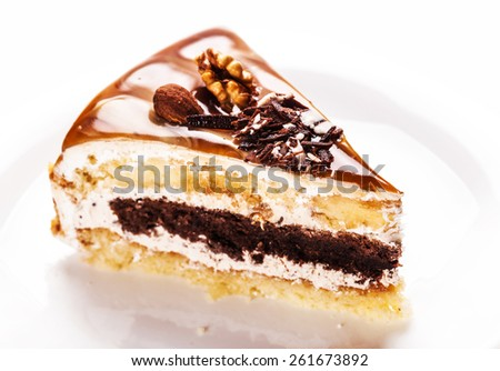 fresh nutty piece of cake on a white background
