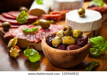 Fresh olives and antipasto catering platter - stock photo