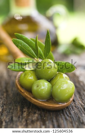 Fresh olives on a spoon - stock photo