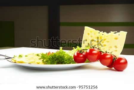 Fresh omelette with vegetables on a plate