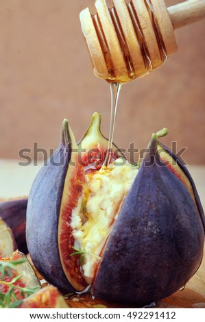 Fresh opened figs with cheese and honey .