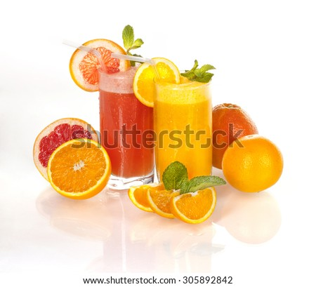 Fresh orange and grapefruit juice on a homogeneous background / Fresh orange and grapefruit juice /  - stock photo