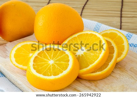 Fresh orange fruit and slices orange on the table - stock photo