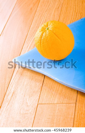 Fresh orange fruit in a blue plate