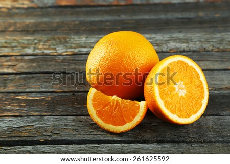 Fresh orange fruit on wooden background - stock photo