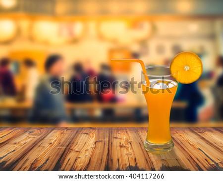 fresh orange juice on wooden table at the restaurant - stock photo