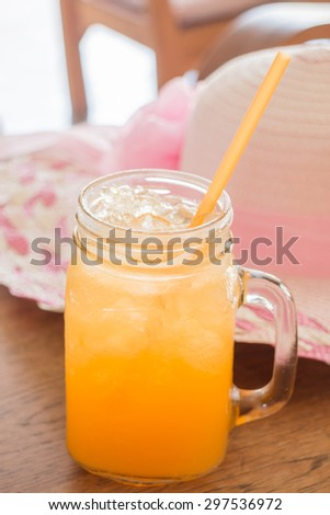 Fresh orange juice serving on wooden table, stock photo