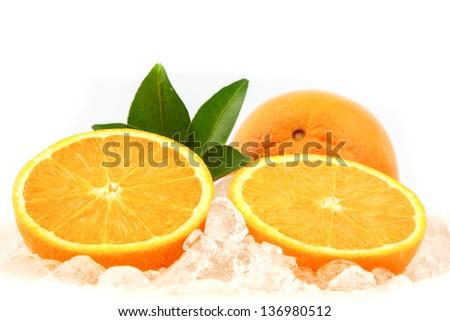 Fresh orange on ice for refreshment - stock photo