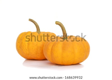 Fresh orange pumpkin isolated on white background.