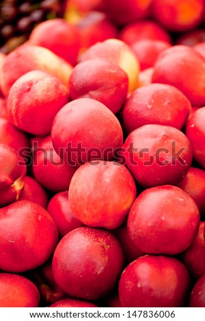fresh orange red apricots peaches macro closeup on market summer
