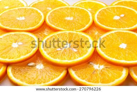 Fresh orange slices, orange background - stock photo