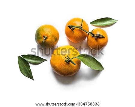 Fresh orange tangerines with leaves isolated on white - stock photo