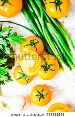 fresh orange tomatoes, juicy summer vegetables and juicy greens, healthy lifestyle and food concept,top view - stock photo