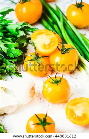 fresh orange tomatoes, juicy summer vegetables and juicy greens, healthy lifestyle and food concept,selective focus - stock photo