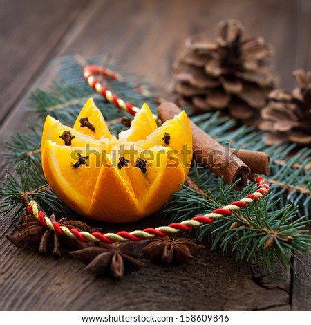 fresh orange with cloves and decoration - stock photo