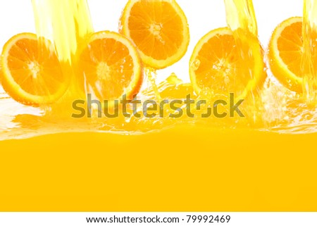 Fresh oranges falling in juice with lot of huge splashes - stock photo