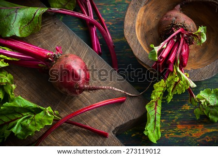 Fresh organic beetroot with green leaves - stock photo