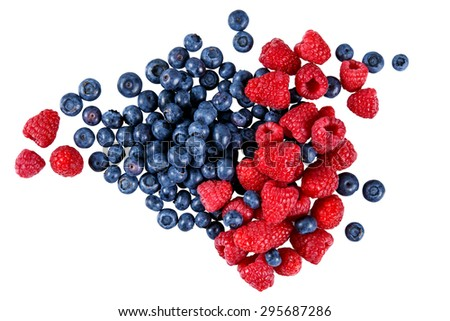 Fresh Organic  Blueberries and Raspberries.  Rich with vitamins. Isolated on white background. - stock photo
