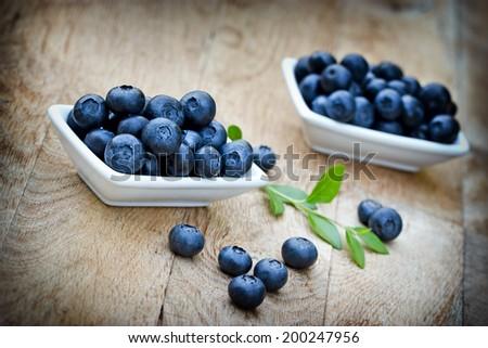Fresh organic blueberry in bowls - stock photo