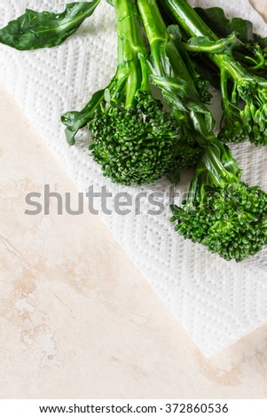 fresh organic broccolini saut�©ed and placed on a white paper towel - stock photo