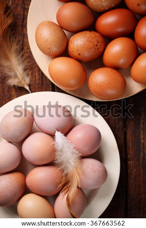fresh, organic, chicken eggs on wooden plates - stock photo