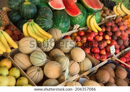 Fresh organic fruits and vegetables on market stall  - stock photo