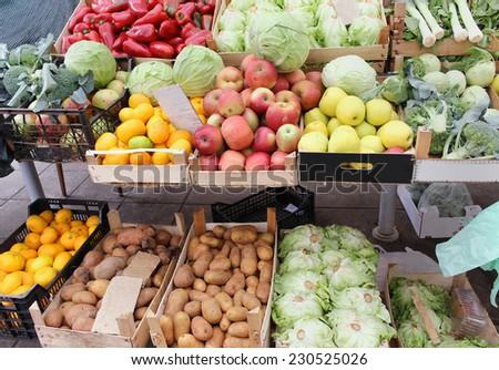 Fresh organic fruits and vegetables on market stall