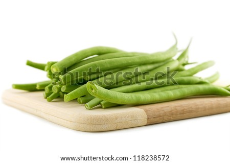 Fresh organic green beans on a cutting board. - stock photo