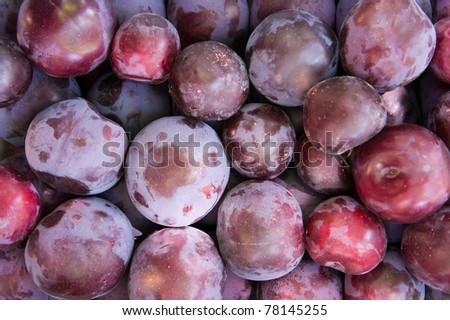 Fresh organic greengage plums at local market for background.