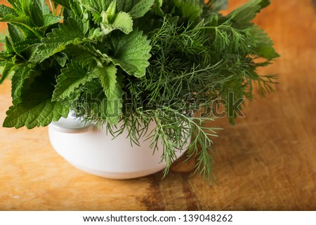 Fresh organic herbs  - mint, lemon balm, fennel on wooden background. Selective focus.