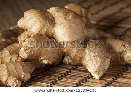 Fresh Organic Oriental Ginger on a background - stock photo