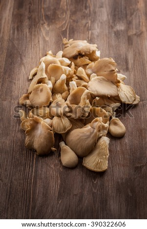 Fresh organic oyster mushrooms on a wooden table