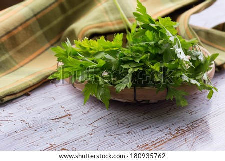 Fresh organic parsley on wooden background. Selective focus. - stock photo