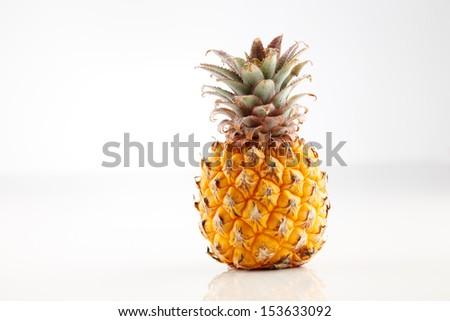 Fresh organic pineapple on a white background - stock photo