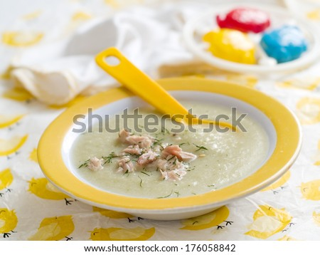 Fresh, organic pureed vegetables soup with chicken for baby. Shot for a story on homemade, organic, healthy baby foods.  - stock photo