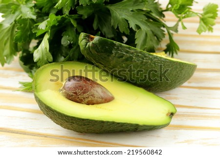 fresh organic ripe avocado on a wooden table - stock photo