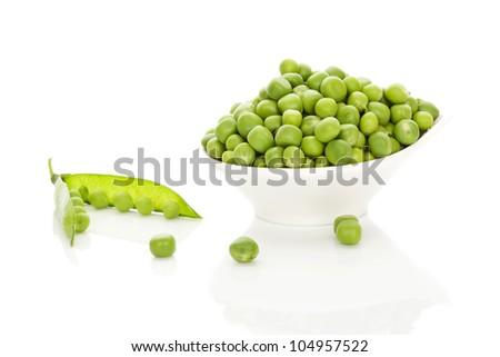 Fresh organic tasty peas in white bowl isolated on white background. Fresh tasty summer vegetable. - stock photo