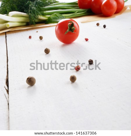 Fresh organic vegetable set of tomatoes dill and onion on white kitchen table - stock photo