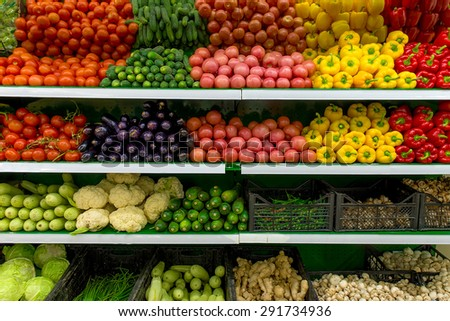 Fresh organic Vegetables and fruits on shelf in supermarket, farmers market. Healthy food concept. Vitamins and minerals. Tomatoes, paprika, capsicum, cucumbers, cabbage, mushrooms, zucchini, squash - stock photo